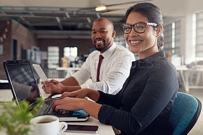 Buy stock photo Shot of two colleagues working together in the office