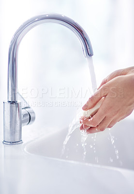 Buy stock photo Shot of hands being washed at a tap