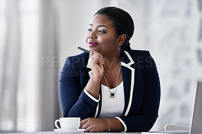 Buy stock photo Shot of a thoughtful young businesspeople working at her desk in an office