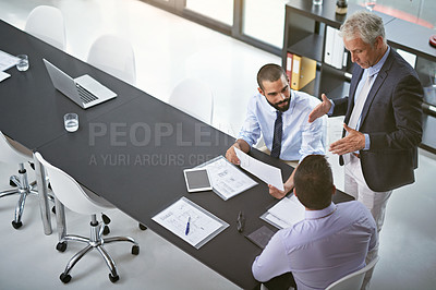 Buy stock photo Shot of corporate businesspeople having a meeting in an office