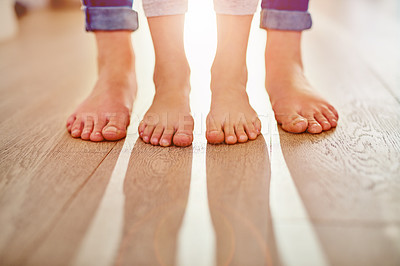 Buy stock photo Closeup shot of a mother and her child's feet together