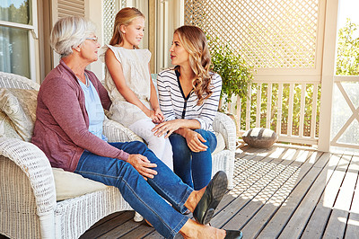Buy stock photo Full length shot of a young girl sitting outside with her mother and grandmother