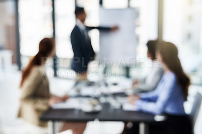 Buy stock photo Defocussed shot of a group of businesspeople attending a presentation