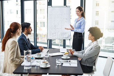 Buy stock photo Shot of a group of businesspeople attending a presentation
