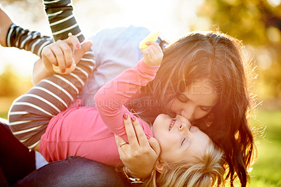 Buy stock photo Shot of a mother and her young daughter playing together at the park