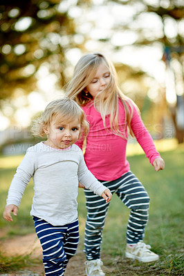 Buy stock photo Cropped shot of two little girls playing in the park