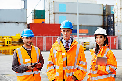 Buy stock photo Portrait of three workers standing on a commercial dock