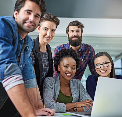 Buy stock photo Portrait of colleagues working together on a laptop in a modern office