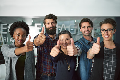 Buy stock photo Cropped shot of a group of creative businesspeople showing thumbs up