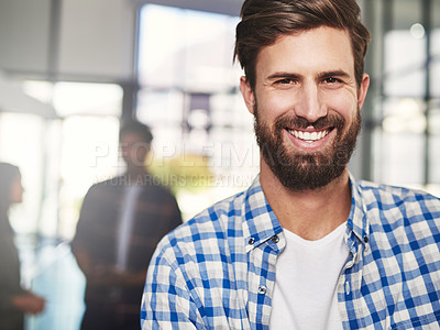 Buy stock photo Portrait of a young designer standing in a modern office with colleagues in the background