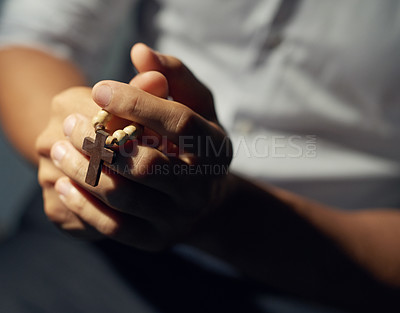 Buy stock photo Cropped shot of a man's hands holding a rosary