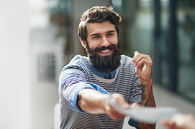 Buy stock photo Cropped shot of a creative businessperson handing a file to his colleague