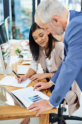 Buy stock photo Cropped shot of two businesspeople working together in the office
