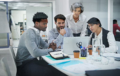 Buy stock photo Cropped shot of a group of colleagues brainstorming together on a laptop in a modern office