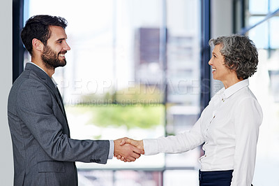 Buy stock photo Cropped shot of businesspeople shaking hands in a modern office