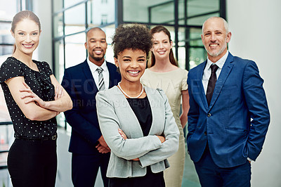 Buy stock photo Cropped portrait of a diverse group of businesspeople standing with their arms crossed in their office