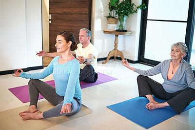 Buy stock photo Shot of a yoga instructor guiding a senior couple in a yoga class