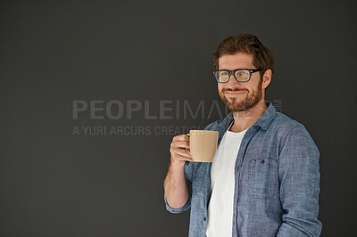 Buy stock photo Studio portrait of a young man drinking coffee against a grey background