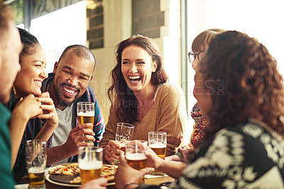 Buy stock photo Shot of a group of friends hanging out and having beer