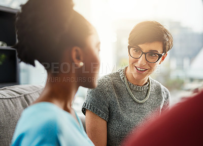 Buy stock photo Shot of businesswomen having a conversation in the office