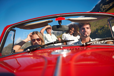 Buy stock photo Shot of a group of friends on a roadtrip together