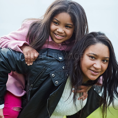 Buy stock photo Cropped portrait of a mother giving her young daughter a piggyback ride