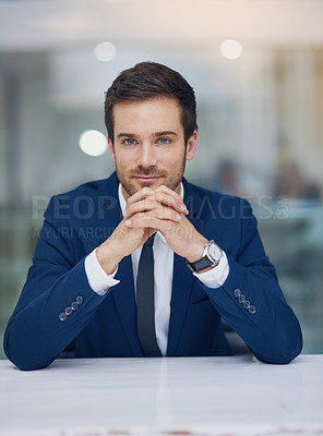 Buy stock photo Portrait of a young businessman sitting in his office