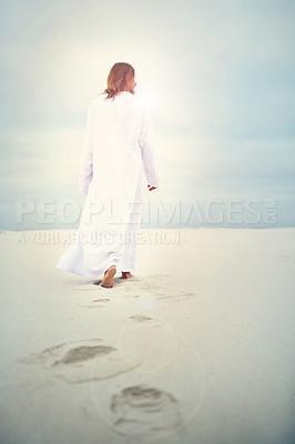 Buy stock photo Shot of Jesus walking in a sandy landscape