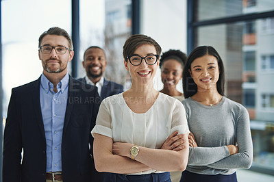 Buy stock photo Portrait of a diverse team of professionals standing in the office