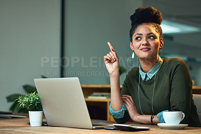 Buy stock photo Shot of an attractive young woman having a lughtbulb moment while working on her laptop in the office