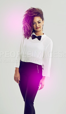 Buy stock photo Shot of a funky young woman posing against a white background