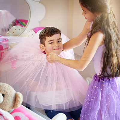 Buy stock photo Shot of a cute little girl playing dress up with her brother at home
