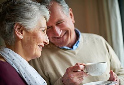 Buy stock photo Shot of a senior couple enjoying soma alone time at home
