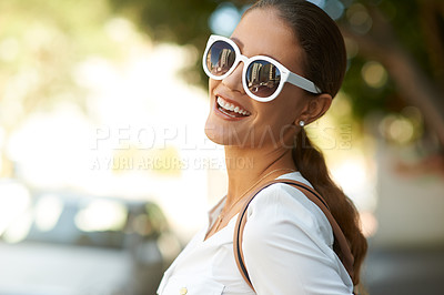 Buy stock photo Portrait of a happy young woman enjoying a day out in the city