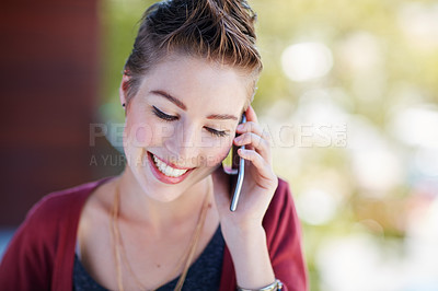 Buy stock photo Shot of an attractive young businesswoman using her cellphone while standing on her office balcony
