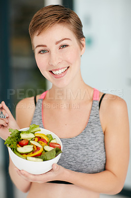 Buy stock photo Portrait of a fit young woman eating a bowl of salad