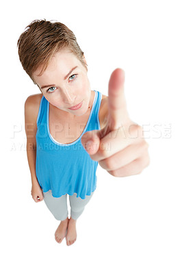 Buy stock photo Studio shot of a young woman pointing against a white background
