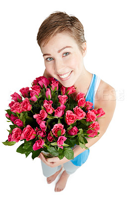 Buy stock photo Studio shot of a young woman holding a bouquet of roses against a white background