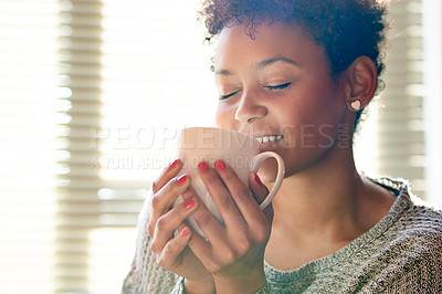 Buy stock photo Cropped shot of a young woman relaxing at home with a cup of coffee