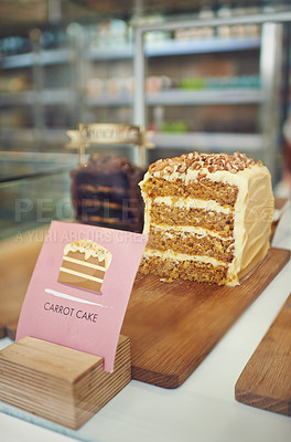 Buy stock photo Shot of cakes in a display case in a cake shop