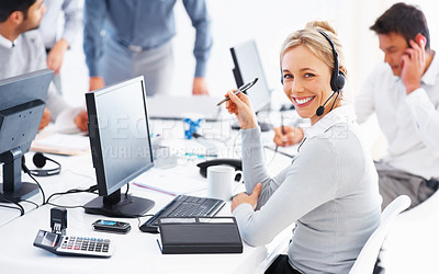 Buy stock photo Beautiful customer service executive with colleagues in background