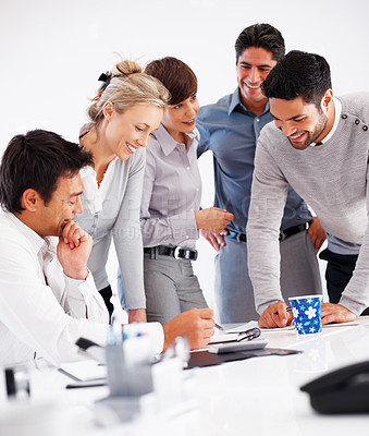 Buy stock photo Team of smiling professionals discussing project in conference room