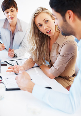 Buy stock photo Attractive business woman discussing with colleagues during meeting