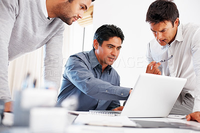 Buy stock photo Male leader with his colleagues discussing business plan on laptop