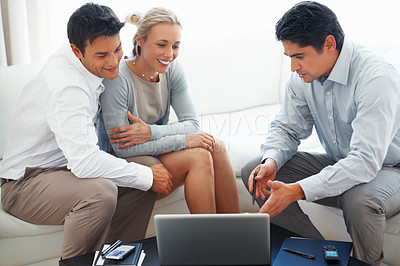 Buy stock photo Business consultant explaining investment plans on laptop to couple