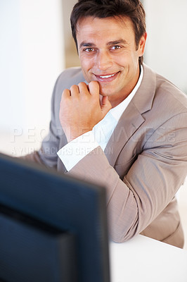 Buy stock photo Portrait of smart smiling business man working on computer and looking at you