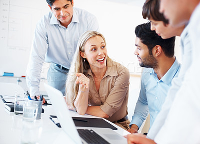 Buy stock photo Business woman sitting at table and discussing project with colleagues on laptop