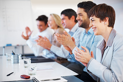 Buy stock photo Group of business people sitting at conference table and applauding