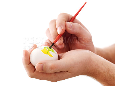 Buy stock photo Closeup human hand painting easter egg with paintbrush isolated on white background