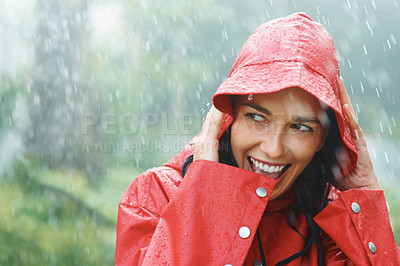 Buy stock photo Pretty woman looking mischievous while in rain